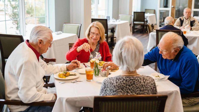 Seniors enjoying lunch in dining room