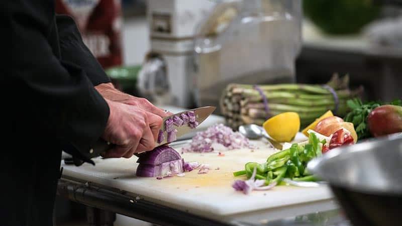 Chef chopping fresh ingredients