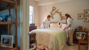 Housekeeping staff making bed